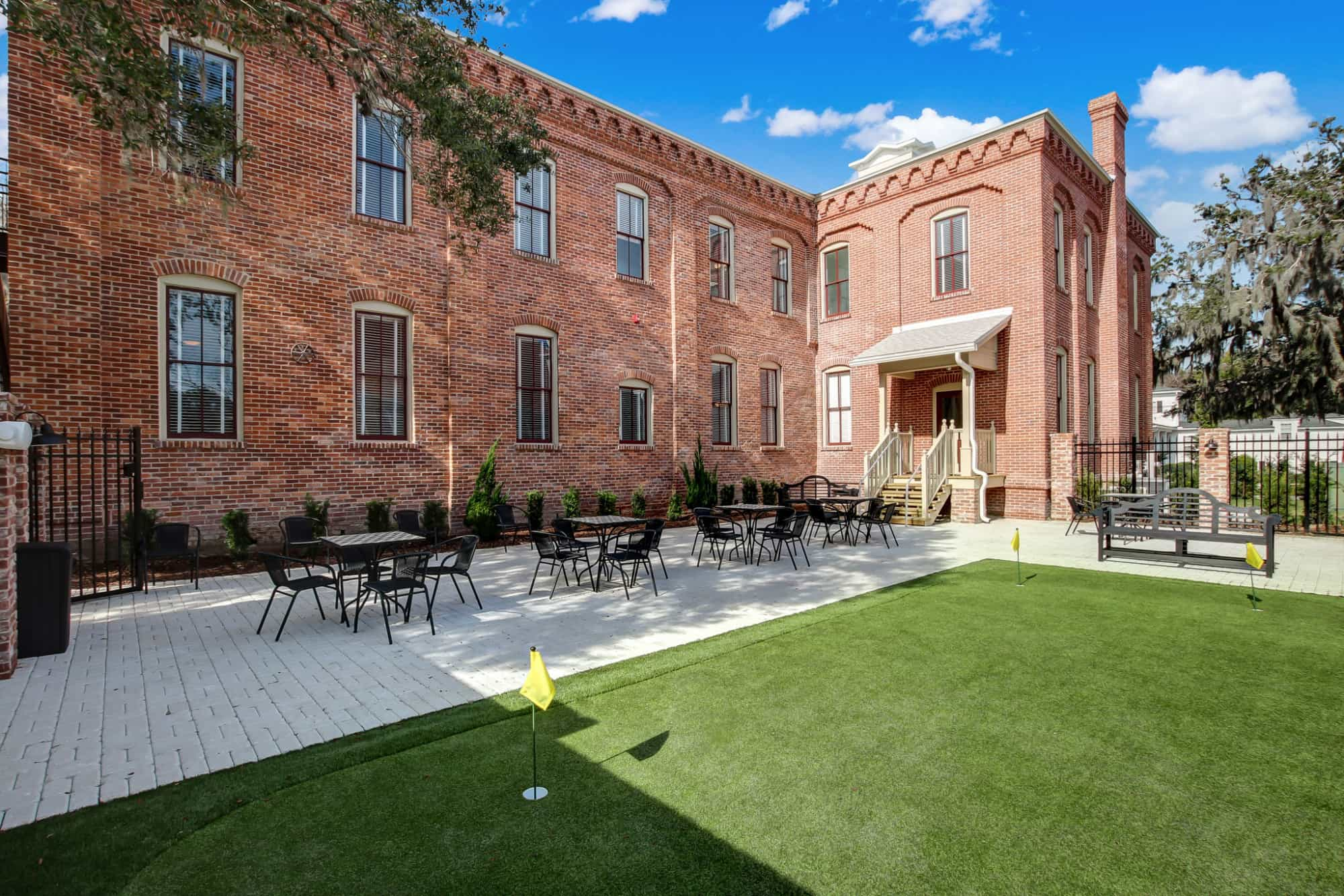 Amelia Schoolhouse Courtyard & Putting green